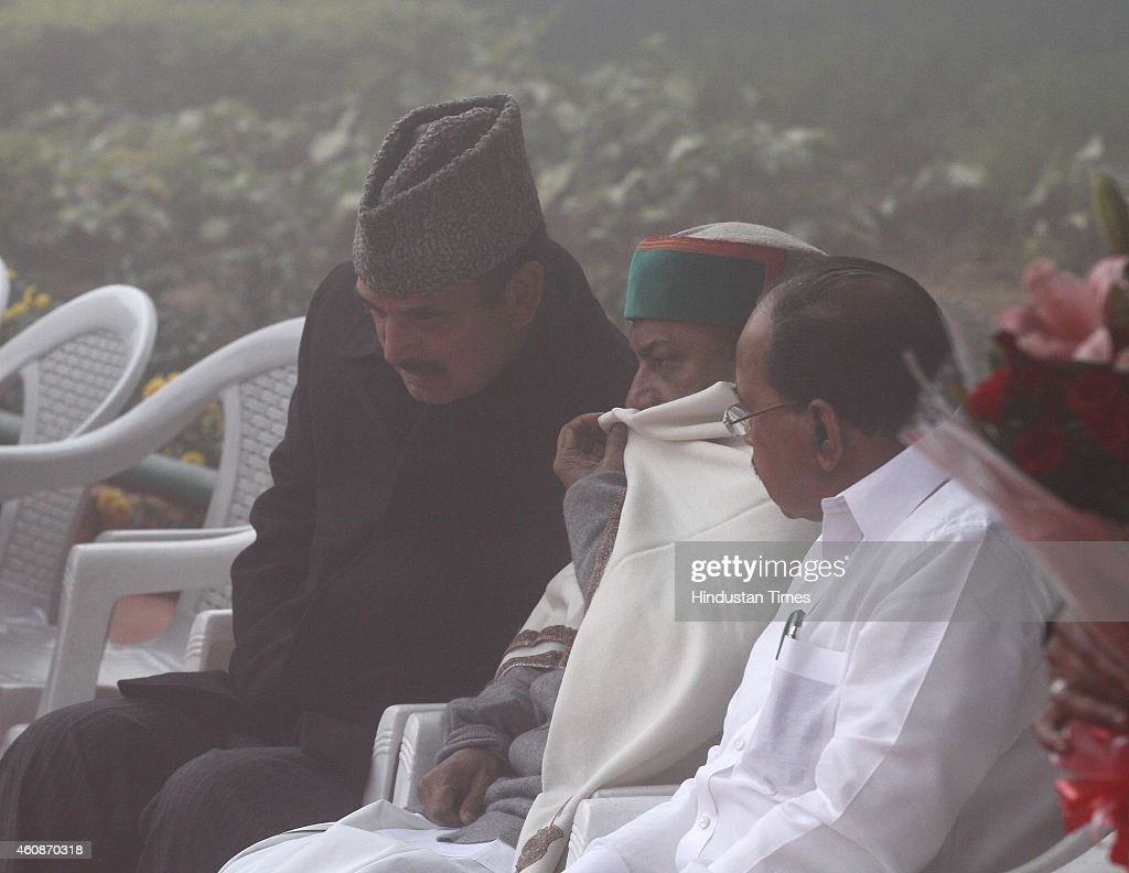 Congress leaders <a gi-track='captionPersonalityLinkClicked' href=/galleries/search?phrase=Ghulam+Nabi+Azad&family=editorial&specificpeople=772783 ng-click='$event.stopPropagation()'>Ghulam Nabi Azad</a>, AK Antony, Veerapa Moily, <a gi-track='captionPersonalityLinkClicked' href=/galleries/search?phrase=Ghulam+Nabi+Azad&family=editorial&specificpeople=772783 ng-click='$event.stopPropagation()'>Ghulam Nabi Azad</a> and others after flag hoisting during Congress Partys 130th foundation day at AICC HQ during heavy fog on December 28, 2014 in New Delhi, India.