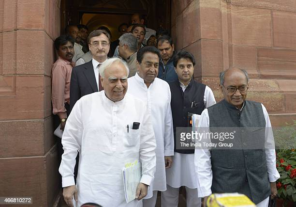 Congress leaders Jyotiraditya Scindia Kamalnath Digcijaya Singh and Kapil Sibal talking to media at Parliament during Parliament Budget Session