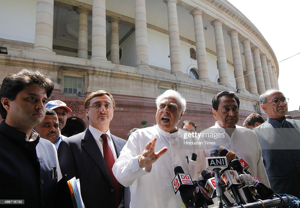 Congress leaders <a gi-track='captionPersonalityLinkClicked' href=/galleries/search?phrase=Kapil+Sibal&family=editorial&specificpeople=791656 ng-click='$event.stopPropagation()'>Kapil Sibal</a>, Digvijay Singh, <a gi-track='captionPersonalityLinkClicked' href=/galleries/search?phrase=Kamal+Nath&family=editorial&specificpeople=569782 ng-click='$event.stopPropagation()'>Kamal Nath</a>, Jyotiraditya Scindia talking to media after meeting with Prime Minister Narendra Modi on Vyapam Scam issue at the Parliament during Budget session on March 18, 2015 in New Delhi, India. The coal bill, the mines and minerals bill and the land bill are required to be passed in parliament to replace the ordinances promulgated by the government. The ordinances lapse on April 5.