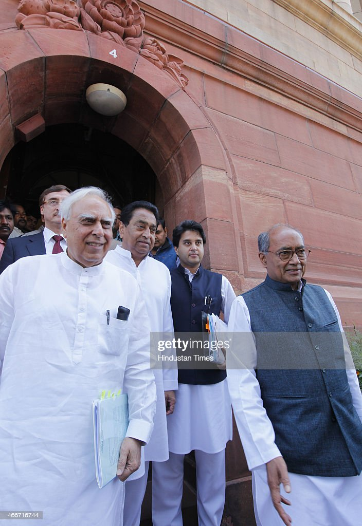 Congress leaders <a gi-track='captionPersonalityLinkClicked' href=/galleries/search?phrase=Kapil+Sibal&family=editorial&specificpeople=791656 ng-click='$event.stopPropagation()'>Kapil Sibal</a>, Digvijay Singh, <a gi-track='captionPersonalityLinkClicked' href=/galleries/search?phrase=Kamal+Nath&family=editorial&specificpeople=569782 ng-click='$event.stopPropagation()'>Kamal Nath</a>, Jyotiraditya Scindia after meeting with Prime Minister Narendra Modi on Vyapam Scam issue at the Parliament during Budget session on March 18, 2015 in New Delhi, India. The coal bill, the mines and minerals bill and the land bill are required to be passed in parliament to replace the ordinances promulgated by the government. The ordinances lapse on April 5.