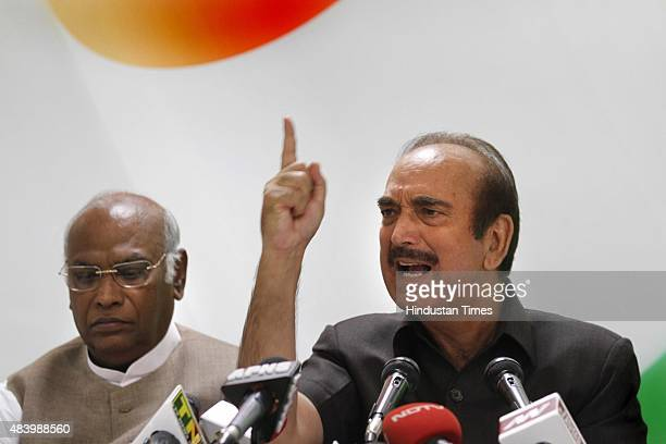 Congress leaders Mallikarjun Kharge along with Ghulam Nabi Azad addressing a press conference against the Modi government at AICC Headquarters on...