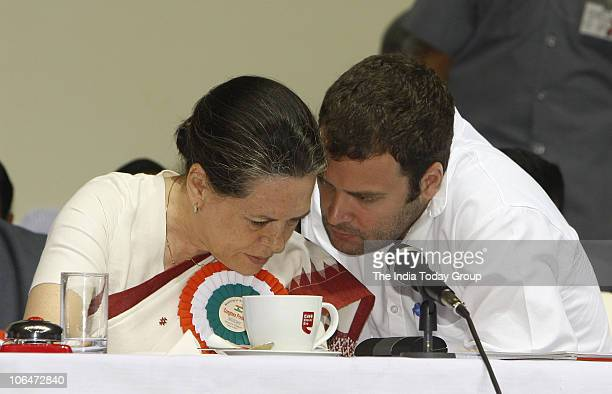 Congress leaders Sonia Gandhi and son Rahul Gandhi exchange discussion during the All India Congress Committee meet in New Delhi on November 2 2010