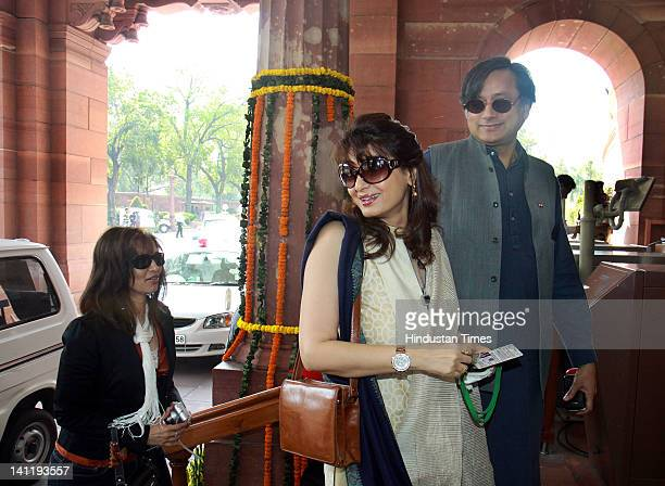 Congress Lok Shabha MP Shashi Tharoor with his wife Sunanda Pushkar arrive to attend the joint session of Parliament on the opening day of Budget...