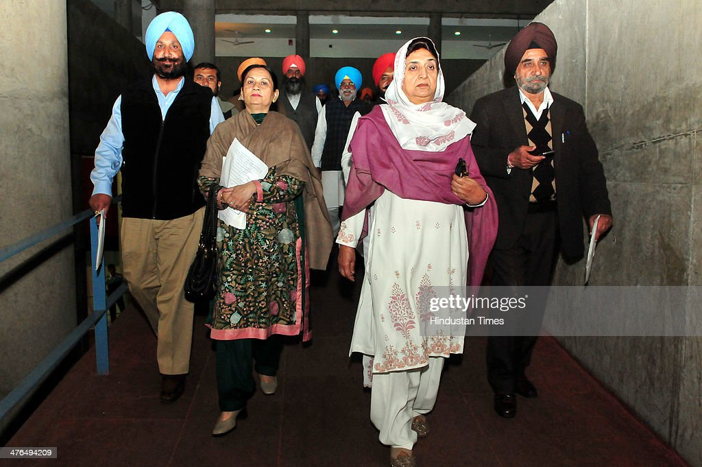 Congress MLAs coming out of Punjab Vidhan Sabha in protest during the inaugural day of budget session at Punjab assembly premises on March 3, 2014 in Chandigarh, India. They were demanding the dismissal of three ministers in the Parkash Singh Badal-led Punjab government for their alleged involvement in illegal activities.