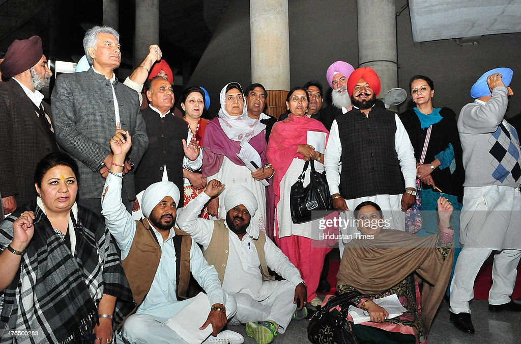 Congress MLAs sitting in protest out of Punjab Vidhan Sabha during the inaugural day of budget session at Punjab assembly premises on March 3, 2014 in Chandigarh, India. They were demanding the dismissal of three ministers in the Parkash Singh Badal-led Punjab government for their alleged involvement in illegal activities.