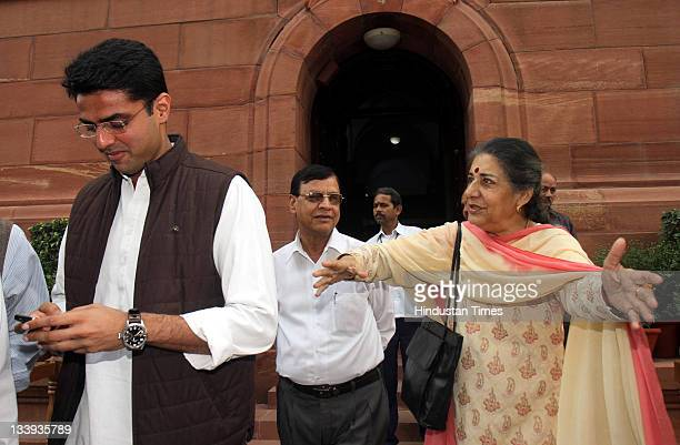 Congress MP Ambika Soni and Sachin Pilot at Parliament house on the first day of its winter session on November 22 2011 in New Delhi India