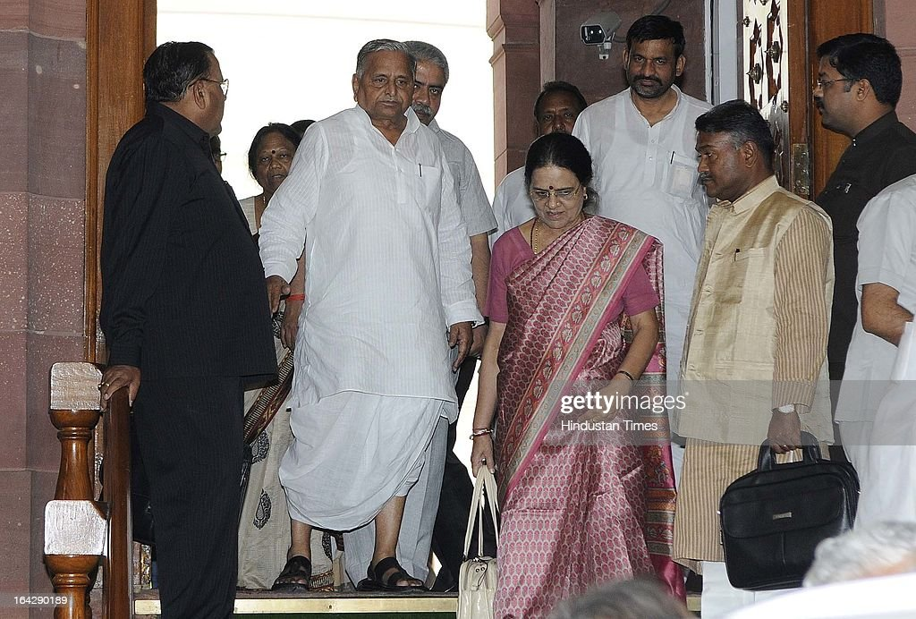 Congress MP Girija Vyas speaks with Samajwadi Party Chief Mulayam Singh Yadav leave parliament after attending Parliament budget session on March 21, 2013 in New Delhi, India. Anti-Rape law was passed in Rajya Sabha after it got passed in Lok Sabha two days ago.