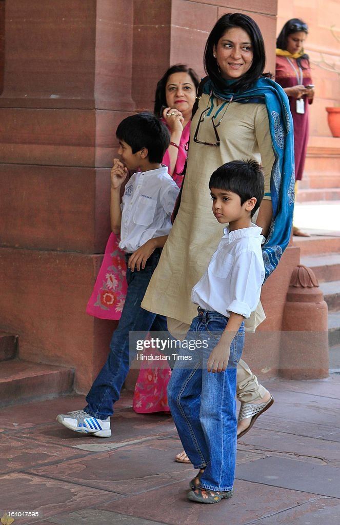 Congress MP Priya Dutt with her kids at Parliament house during the on going budget session on March 19, 2013 in New Delhi, India. DMK today withdrew its support to the UPA and pulled out its five central ministers over the issue of alleged human rights violations of Tamils in Sri Lanka . The DMK has 18 Lok Sabha MPs and six Rajya Sabha MPs and was the second largest constituent of the Government. With the DMK pullout, the strength of the UPA in the Lok Sabha will be reduced to 224 but with outside support of SP (22) and BSP (21) it enjoyed the support of 281 MPs above the half way mark of 270.