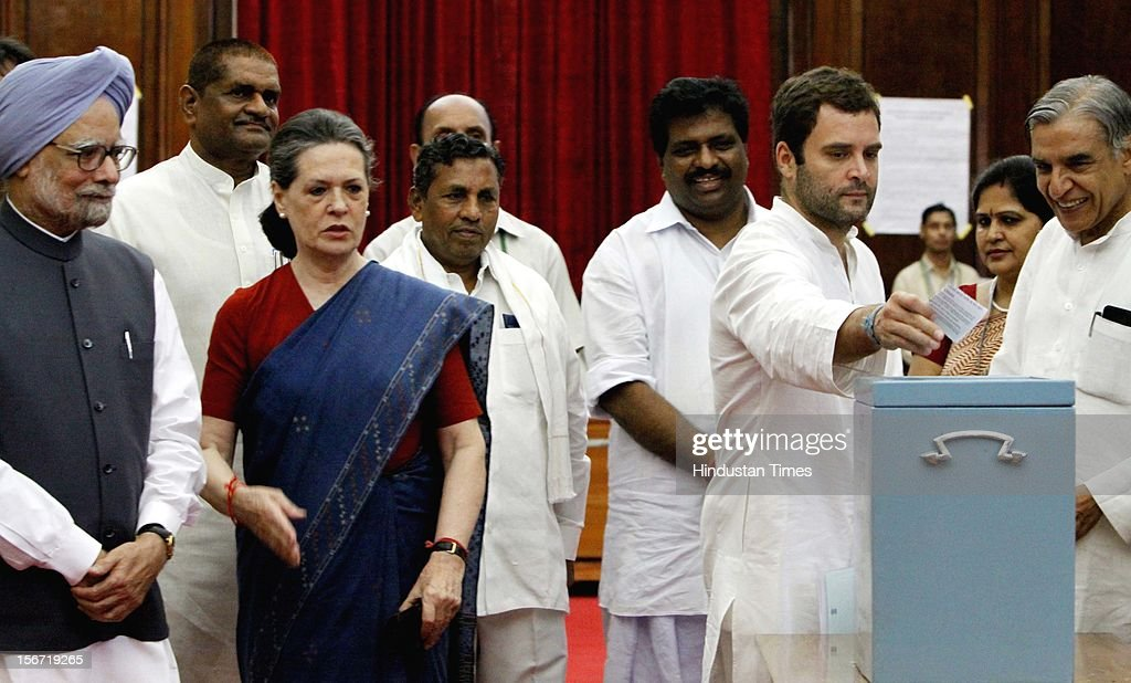 'NEW DELHI, INDIA - AUGUST 7: Congress MP Rahul Gandhi casting vote for the election of Vice President as Prime Minister Manmohan Singh and congress President Sonia Gandhi looks on at Parliament house on August 7, 2012 in New Delhi, India. (Photo by Sunil Saxena/Hindustan Times via Getty Images)'