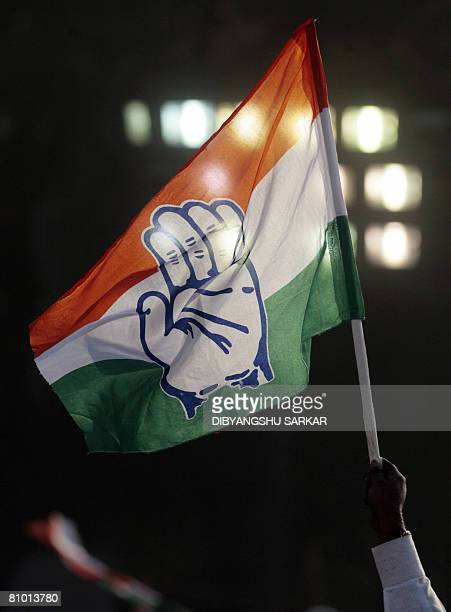 A Congress Party activist waves a party flag during the speech of Congress Party President Sonia Gandhi during an election rally in Bangalore on May...