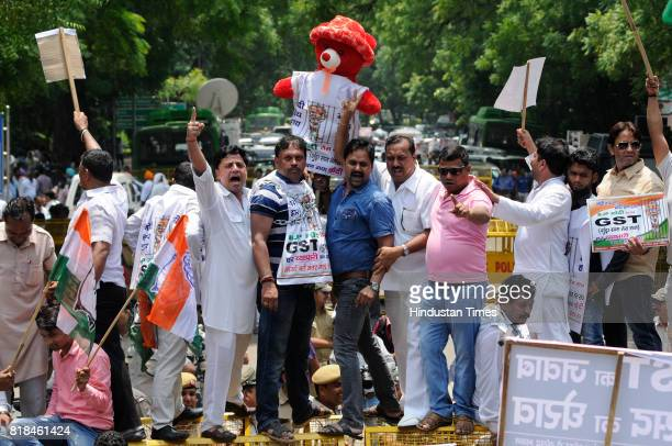 Congress party activists and workers staged a protest march at Jantar Mantar against the implementation of Goods Services Tax on July 18 2017 in New...