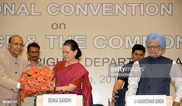 Congress Party Leader Abhishek Singhvi welcomes Congress Party President and Chairperson of the UPA Government Sonia Gandhi with a bouquet as Indian...