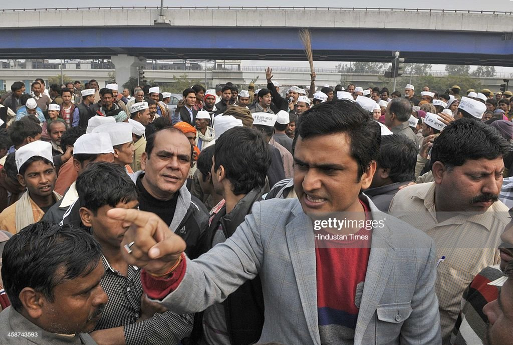 Congress Party leader and former MLA Anil Chaudhary (grey suit) scuffle by the AAP Party members as they were blaming each other for the demolition drive as DDA Officials came to demolish the Jhuggies along the Yamuna River near Mayur Vihar on December 20, 2013 in New Delhi, India.