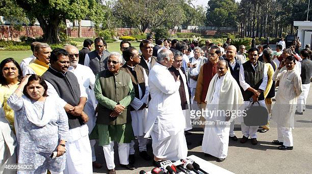 Congress Party leaders AK Antony Mallikarjun Kharge and Subbarami Reddy after taking out a march from the AICC headquarters to the former Prime...