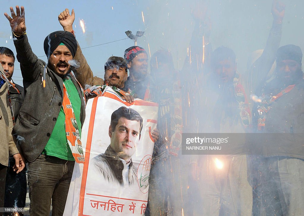 Congress party members set off firecrackers as they celebrate the appointment of Rahul Gandhi as Congress party Vice-President, in Amritsar on January 20, 2013. Rahul Gandhi, newly named to the number two post in India's ruling Congress party, delivered a powerful call for change to meet the aspirations of the nation's 'young and impatient' population