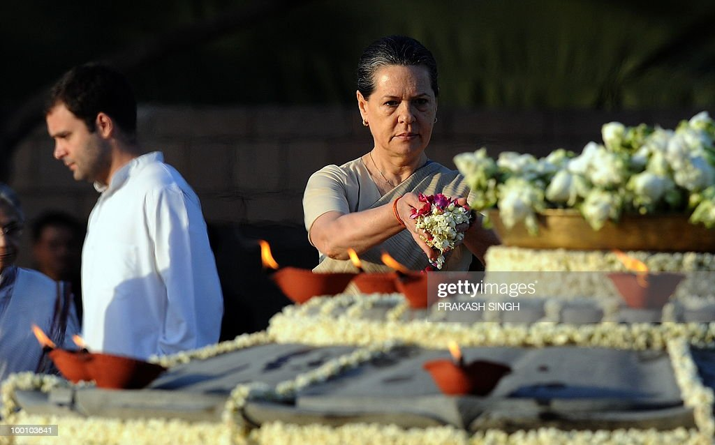 Congress Party president and chairperson of the United Progressive Alliance (UPA), Sonia Gandhi (R) pays tributes during a memorial ceremony for slain former Indian prime minister and husband Rajiv Gandhi on his 19th death anniversary in New Delhi on May 21, 2010. Rajiv Gandhi was assasinated during electoral campaigning, allegedly by Liberation Tigers of Tamil Eelam (LTTE) rebel separatists, in the town of Sriperumpudur in the southern state of Tamil Nadu on May 21, 1991. AFP PHOTO/ Prakash SINGH