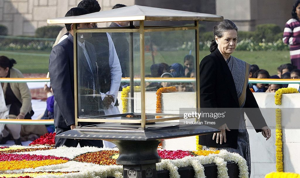 Congress Party President and Chairperson of UPA Government, Sonia Gandhi paying tributes to father of the nation, Mahatma Gandhi on his death anniversary, observed as Martyrs' Day, at Rajghat on January 30, 2013 in New Delhi, India.