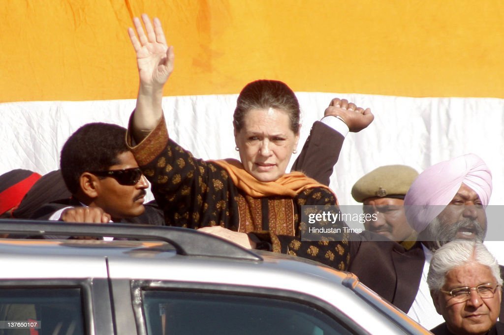 Congress Party President <a gi-track='captionPersonalityLinkClicked' href=/galleries/search?phrase=Sonia+Gandhi&family=editorial&specificpeople=2287581 ng-click='$event.stopPropagation()'>Sonia Gandhi</a> greets supporters during an election rally on January 24, 2012 in Gurdaspur, India. Addressing the rally, Congress Party President lashed out at incumbent SAD-BJP government in Punjab for not utilizing central funds for development of state and pushing Punjab into backwardness.