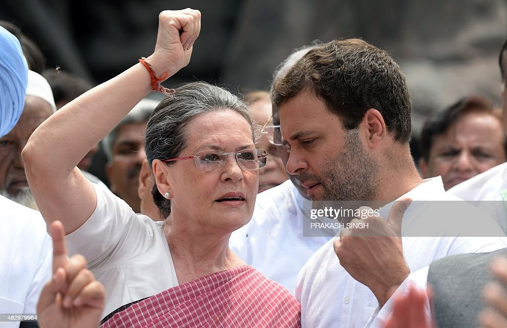 Congress Party President <a gi-track='captionPersonalityLinkClicked' href=/galleries/search?phrase=Sonia+Gandhi&family=editorial&specificpeople=2287581 ng-click='$event.stopPropagation()'>Sonia Gandhi</a> (L) talks with the party vice president and son Rahul Gandhi (R) as they join other Congress Party members of parliament to shout slogans against Prime Minister Narendra Modi and the NDA government at Parliament House in New Delhi on August 5, 2015. Members of the Congress Party, supported by other parties, protested against the suspension of 25 Congress MPs for ''willfully'' disrupting proceedings in the Indian parliament. AFP PHOTO/PRAKASH SINGH