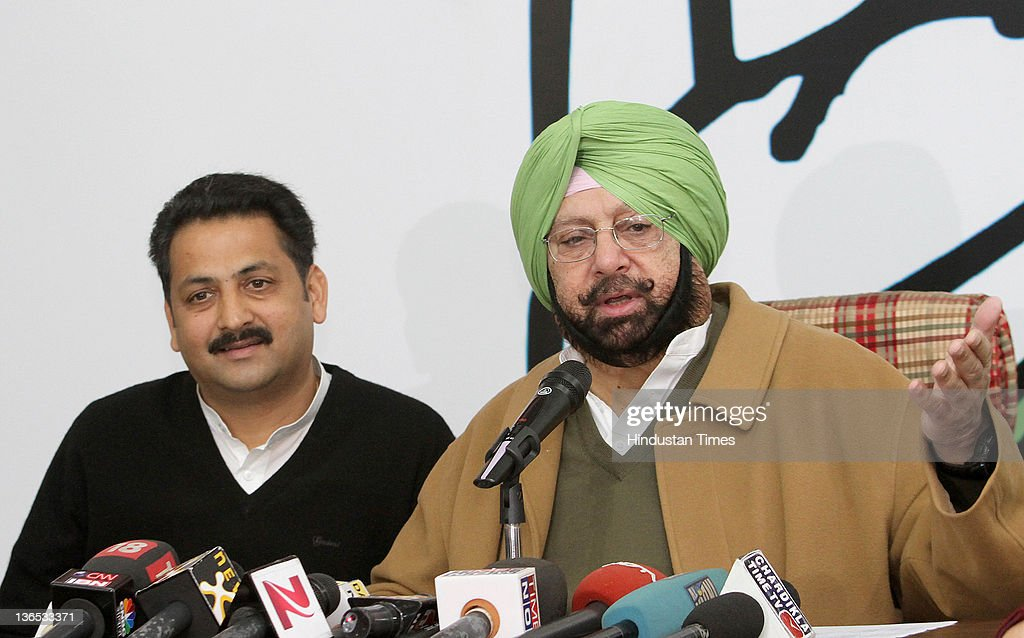 Congress Party State President Capt. <a gi-track='captionPersonalityLinkClicked' href=/galleries/search?phrase=Amarinder+Singh&family=editorial&specificpeople=2907726 ng-click='$event.stopPropagation()'>Amarinder Singh</a> and congress leader Vijay Inder hold a news conference on January 7, 2012 in Chandigarh, India. Singh claimed that tickets were issued on winnability factor and despite dissidence from some party leaders including his younger brother Malwinder Singh who joined rival Shiromani Akali Dal, the Congress Party will win a comfortable majority in upcoming elections in Punjab.