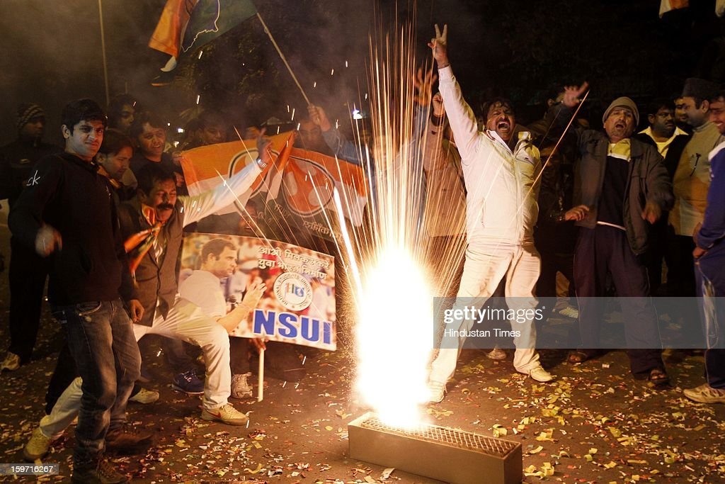 Congress Party supporters burst crackers to celebrate outside the AICC after announcement of Rahul Gandhi being made vice-president of Party at Chintan Shivir on January 19, 2013 in New Delhi, India.