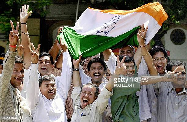 Congress party supporters jubilate as they hear on a loud speaker outside the tally rooms the progressive election results of their candidate and...
