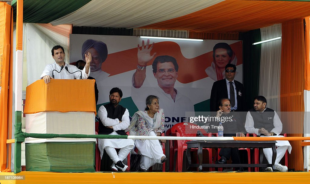 Congress Party Vice President Rahul Gandhi addressing a rally of Congress sarpanchs at MA Stadium on November 6, 2013 in Jammu, India. High drama was witnessed at a meeting with a sarpanch accusing Omar Abdullah-led government of doing nothing for panchayat officials as the Congress Vice-President made a strong pitch for empowering the grassroot institutions.