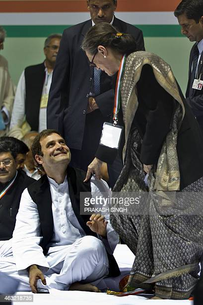 Congress Party Vice President Rahul Gandhi talks with his mother Congress Party President Sonia Gandhi during the All India Congress Committee...