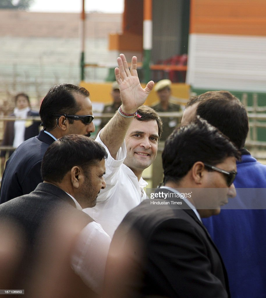 Congress Party Vice President Rahul Gandhi waves to sarpanches after a rally of Congress sarpanchs at MA Stadium on November 6, 2013 in Jammu, India. High drama was witnessed at a meeting with a sarpanch accusing Omar Abdullah-led government of doing nothing for panchayat officials as the Congress Vice-President made a strong pitch for empowering the grassroot institutions.