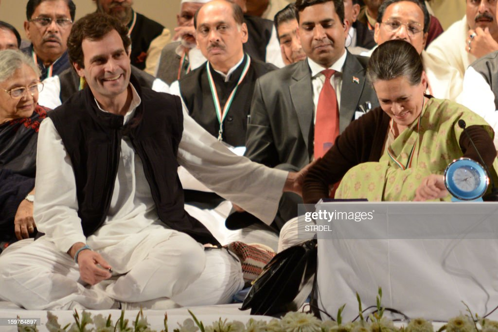 Congress party Vice-President Rahul Gandhi (L) gestures as he shares a light moment with his mother, Congress Party President Sonia Gandhi (R), during the Congress party leadership conclave in Jaipur on January 20, 2013. Rahul Gandhi, newly named to the number two post in India's ruling Congress party, delivered a powerful call for change to meet the aspirations of the nation's 'young and impatient' population. AFP PHOTO/STR