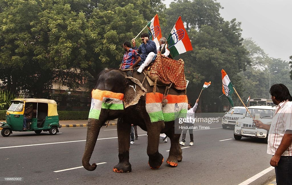 Congress Party workers are traonsported on an elephant at Rafi Marg on November 04, 2012 in New Delhi, India. The rally is expected to set the agenda for the party's one-day brainstorming session at Surajkund on November 9 in which it plans to discuss the current political and economic situation.