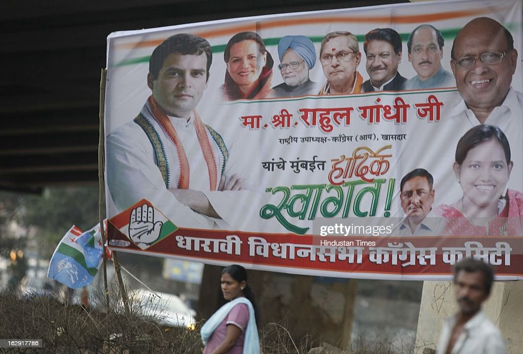 Congress party workers hang the poster on western express highway near airport to welcome the Congress vice president Rahul Gandhi on March 1, 2013 in Mumbai, India. Rahul Gandhi is visiting Mumbai for the first time after he took over as Congress vice president.