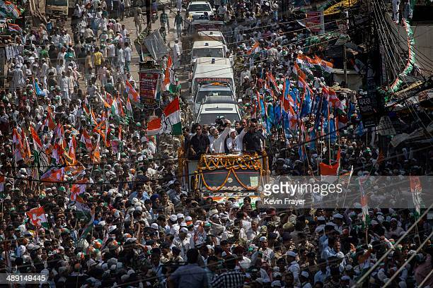 Congress Party's Rahul Gandhi center waves to supporters at a rally on May 10 2014 in Varanasi India India is in the midst of a ninephase election...