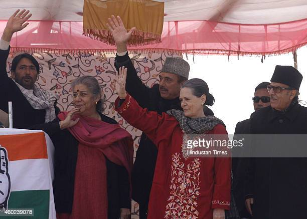 Congress President Sonia Gandhi along with Congress leaders Ghulam Nabi Azad Ambika Soni Saifuddin Soz and Ghulam Ahmad Mir waving at crowd during an...