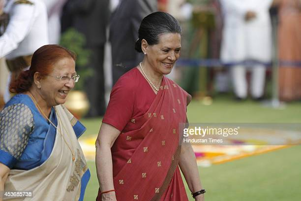 Congress president Sonia Gandhi along with Lok Sabha speaker Sumitra Mahajan during at home on Independence Day at Rashtrapati Bhawan on August 15...