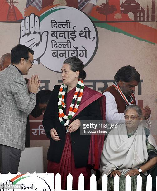 Congress President Sonia Gandhi along with party leaders Ajay Maken and Sheila Dikshit during an election rally at Meethapur near Badarpur on...