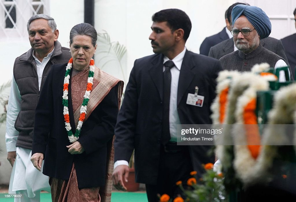 Congress president Sonia Gandhi along with Prime Minister Manmohan Singh , during the Indian National Congress party's 127th foundation day function at AICC headquarters on December 28, 2012 in New Delhi, India.