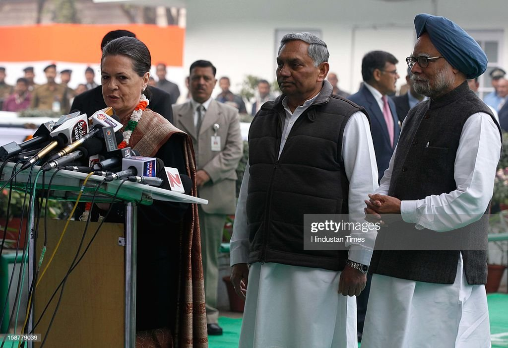 Congress president Sonia Gandhi along with Prime Minister Manmohan Singh and Janardan Dwivedi speaks to media person, during the Indian National Congress party's 127th foundation day function at AICC headquarters on December 28, 2012 in New Delhi, India.