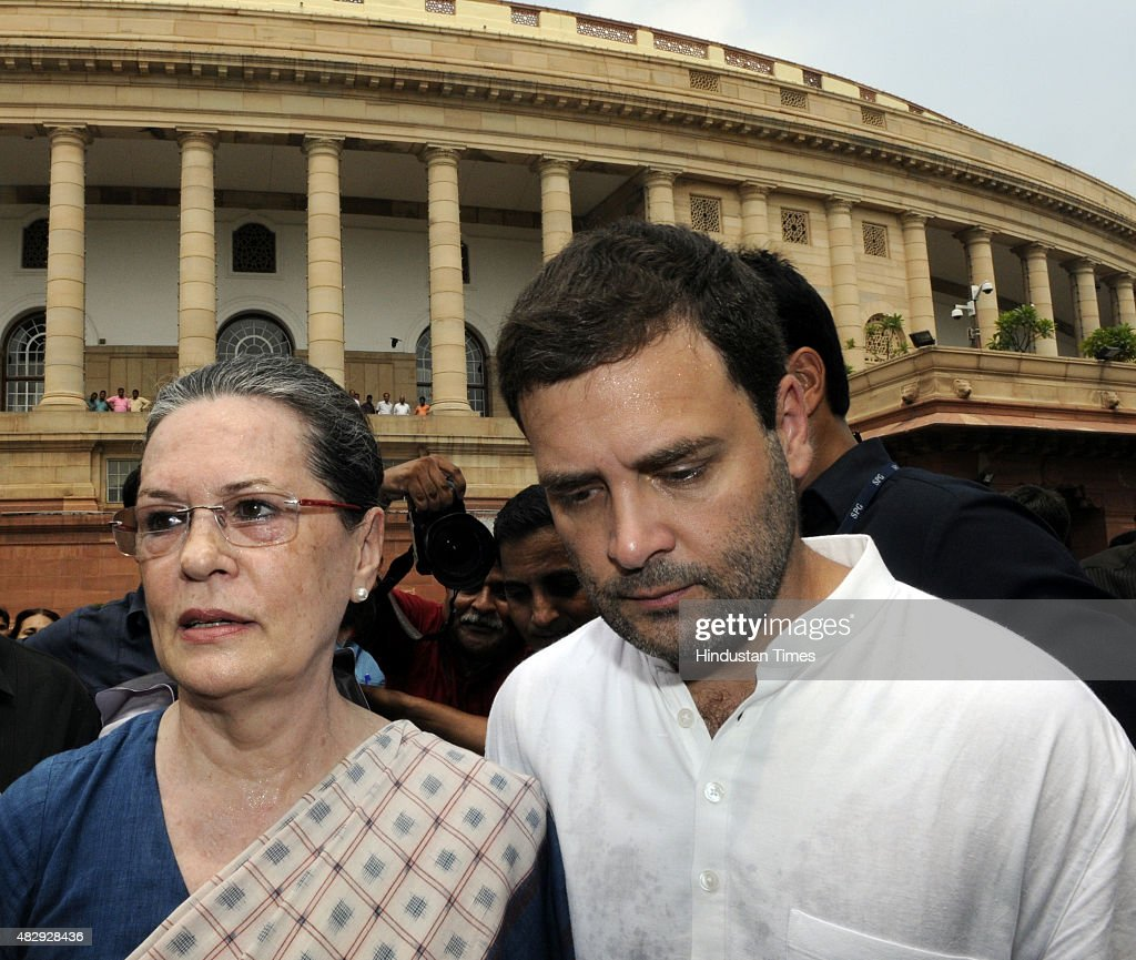 Congress President <a gi-track='captionPersonalityLinkClicked' href=/galleries/search?phrase=Sonia+Gandhi&family=editorial&specificpeople=2287581 ng-click='$event.stopPropagation()'>Sonia Gandhi</a>, and Congress Vice President <a gi-track='captionPersonalityLinkClicked' href=/galleries/search?phrase=Rahul+Gandhi&family=editorial&specificpeople=171802 ng-click='$event.stopPropagation()'>Rahul Gandhi</a> after their protest against the suspension of their 25 members by the Lok Sabha speaker at Parliament complex on August 4, 2015 in New Delhi, India. Opposition parties including SP, RJD, Trinamool Congress and the Left also joined with Congress in boycotting the Lok Sabha, paralyzing the upper house and protest.