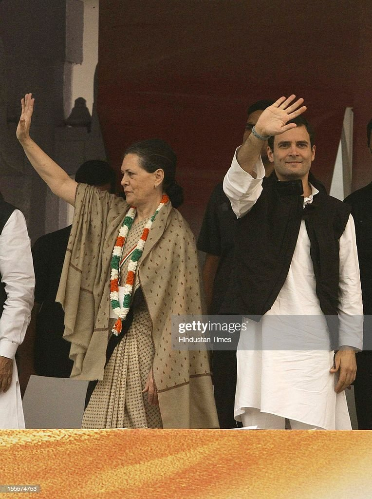 Congress President Sonia Gandhi and General Secretary Rahul Gandhi (R) wave to the crowd during the party's Maharally at Ramlila Maidan on November 04, 2012 in New Delhi, India. The rally is expected to set the agenda for the party's one-day brainstorming session at Surajkund on November 9 in which it plans to discuss the current political and economic situation.