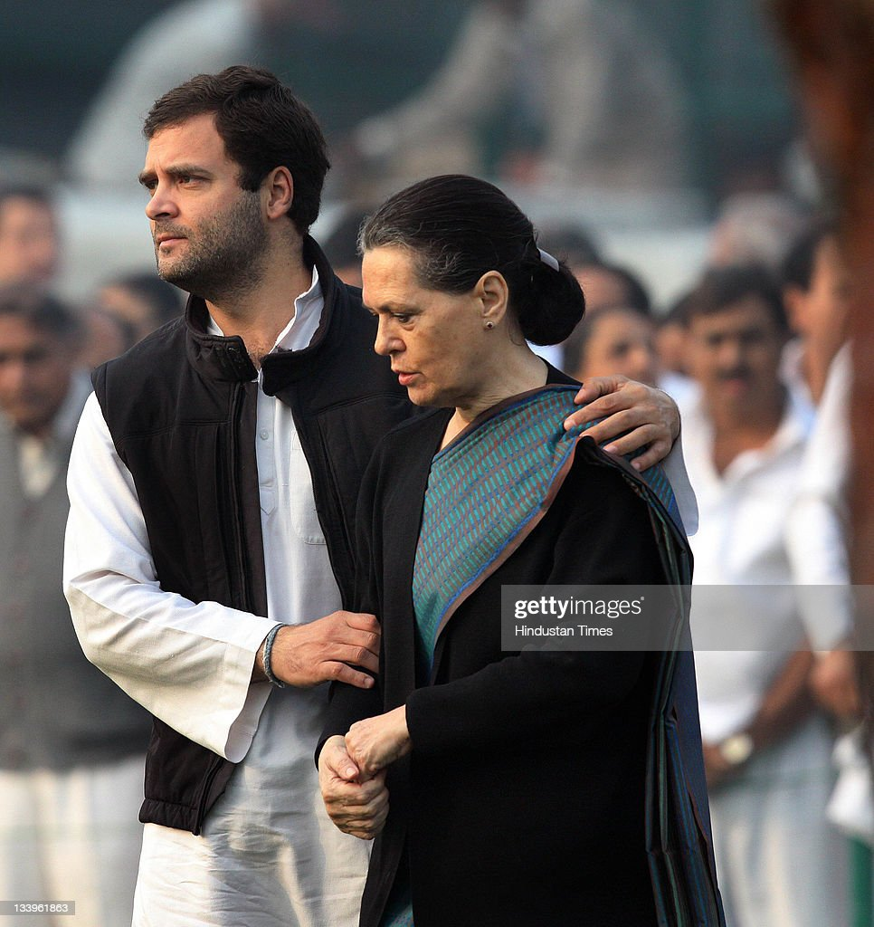 Congress President <a gi-track='captionPersonalityLinkClicked' href=/galleries/search?phrase=Sonia+Gandhi&family=editorial&specificpeople=2287581 ng-click='$event.stopPropagation()'>Sonia Gandhi</a> (R) and her son <a gi-track='captionPersonalityLinkClicked' href=/galleries/search?phrase=Rahul+Gandhi&family=editorial&specificpeople=171802 ng-click='$event.stopPropagation()'>Rahul Gandhi</a> (L) after paying tributes to Indira Gandhi on her 94th birth anniversary at her memorial Shakti Sthal on November 19, 2011 in New Delhi, India..