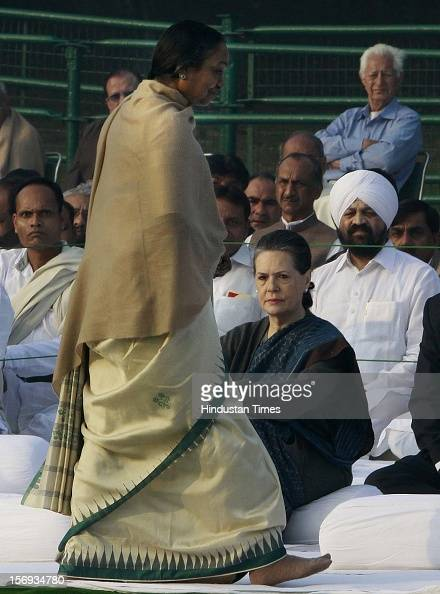 Congress President Sonia Gandhi and Lok Sabha Speaker Meira Kumar after after paying tributes to Indira Gandhi on her 95th birth anniversary at her...