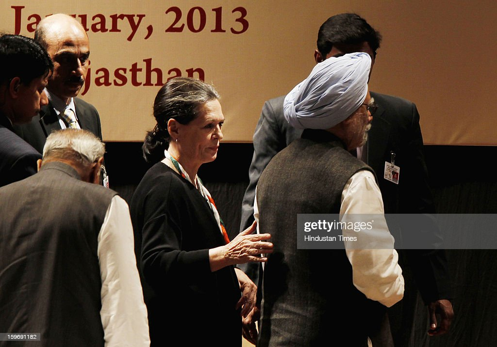 Congress President Sonia Gandhi and Prime Minister Manmohan Singh leave after the inaugural speech during the Chintan Shivir at Birla Auditorium, Jaipur on January 18, 2013 in Rajasthan, India. The Congress' brain-storming session began in Jaipur today and the focus is on the 2014 elections and Rahul Gandhi's role in leading the party in the battle. The ruling party hopes to emerge from the two-day-long session armed with strategy on, among other things, how to reconnect with an angry urban middle class.
