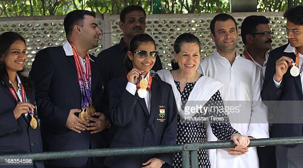 Congress President Sonia Gandhi and Rahul Gandhi pose for a photo with Indian shooters Gagan Narang Heena Sidhu Deepak and others who won medals in...