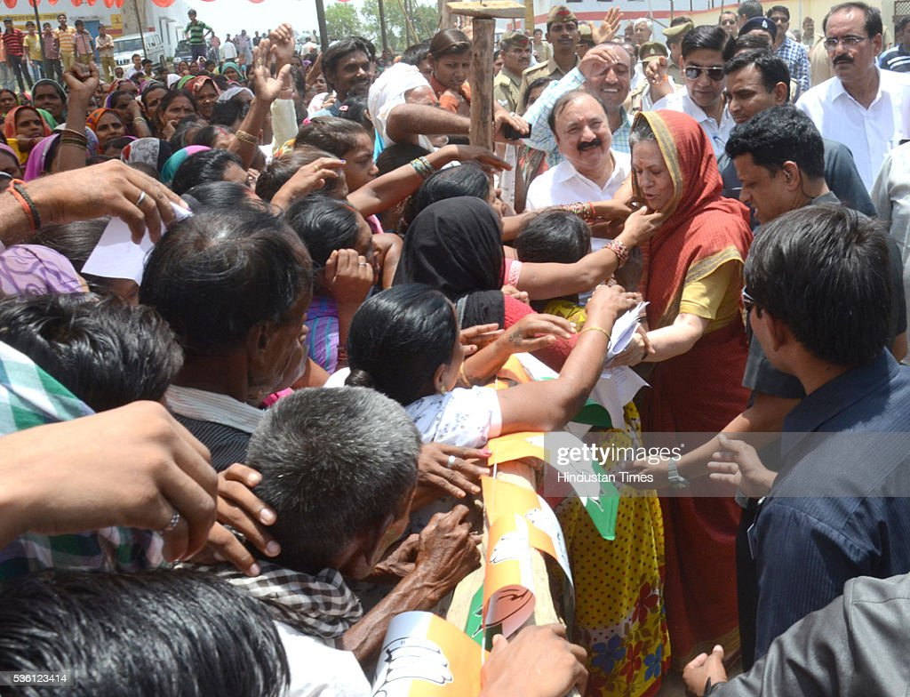 Congress President Sonia Gandhi collecting the pleas from people during a public rally on May 31, 2016 in Raebareli, India. Sonia, who is on a two-day visit to Rae Bareli reacted strongly to reports of alleged links of her son-in-law Robert Vadra with an arms dealer and a property in London and said that one family was being targeted every day as part of a well planned conspiracy.