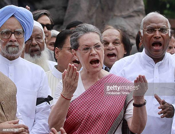 Congress President Sonia Gandhi former Prime Minister Manmohan Singh and other leaders near the Gandhi statue during a protest against suspension of...