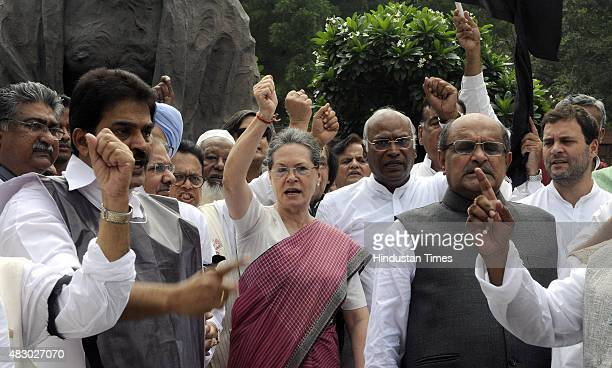 Congress President Sonia Gandhi former Prime Minister Manmohan Singh with JD leader Sharad Yadav and other Members of Parliament shout slogans...