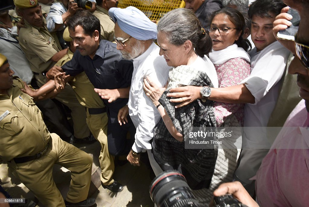Congress president Sonia Gandhi, former prime minister Manmohan Singh were briefly arrested at the Parliament Street police station during their Save Democracy march from Jantar Mantar to Parliament Street, they were later released on May 6, 2016 in New Delhi, India. The protest march called to highlight what the Congress party terms as Modis attack on democracy saw thousands of party workers gather at Jantar Mantar, the countrys protest capital. Congress president Sonia Gandhi, party vice-president Rahul Gandhi and former prime minister Manmohan Singh were briefly arrested and then released at the Parliament Street police station.