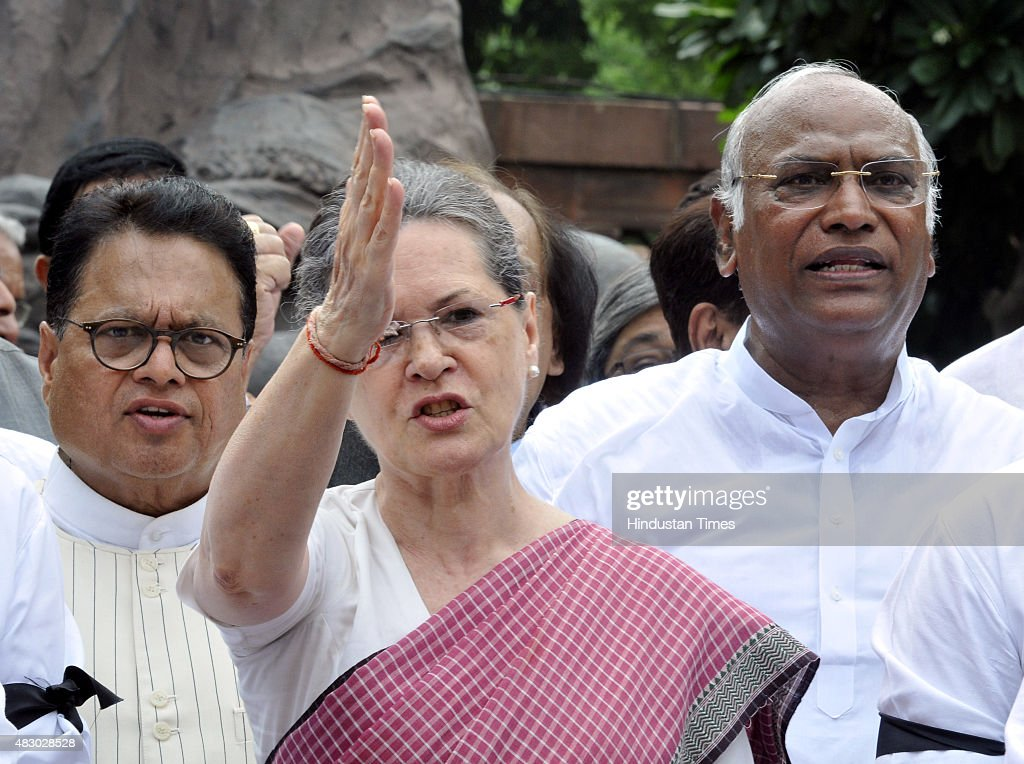 Congress President <a gi-track='captionPersonalityLinkClicked' href=/galleries/search?phrase=Sonia+Gandhi&family=editorial&specificpeople=2287581 ng-click='$event.stopPropagation()'>Sonia Gandhi</a> (C) joins other Congress Party members to shout slogans against Prime Minister Narendra Modi and the NDA government at Parliament House on August 5, 2015 in New Delhi, India. Congress and some opposition parties on Wednesday persisted with their protest against the suspension of 25 MPs as the stalemate in the Rajya Sabha continued over the opposition demand for the resignations of three BJP leaders.
