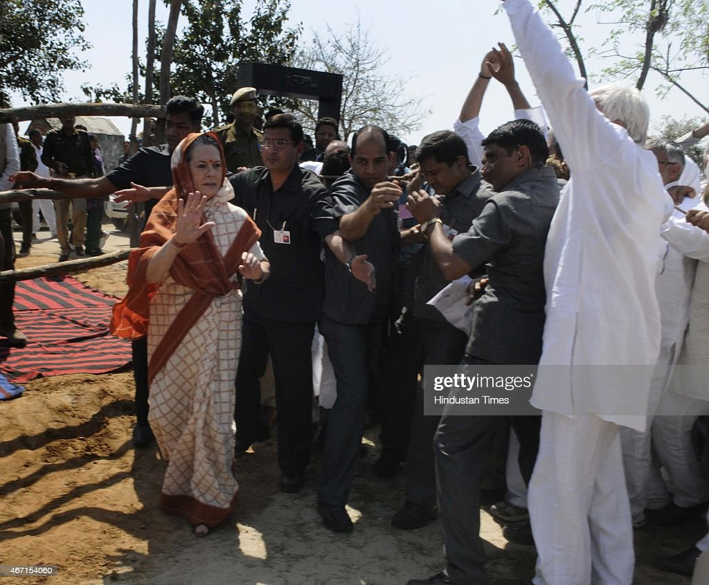 Congress President Sonia Gandhi meets with farmers during her visit at Gurwara village, Haryana, on March 21, 2015 in Rewari, India. Sonia Gandhi visited several villages in Rohtak district including Gurwara, Surakhpur, Jakkhala Road, Gudiani, Mubarikpur Chowk and Rattanthal. She appealed to the Haryana government to assist the rain-affected farmers whose crops have been destroyed by the recent heavy rainfall in Northern India.